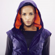 Sportswoman in hoodie looking at camera — Stock Photo