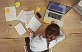 Businesswoman working at her office desk with documents and laptop — Foto de Stock