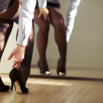 Woman adjusting high heels — Stock Photo