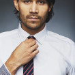 Handsome business executive wearing tie — Stock Photo