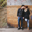 Affectionate teenage couple kissing on street — Stock Photo