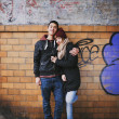 Affectionate couple embracing against a wall — Stock Photo #40688057