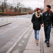 Young couple walking on a sidewalk — Stock Photo #40689197