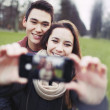 Young couple looking happy taking self portrait — Stock Photo