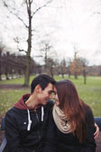 Teenage couple enjoying a day in the park — Stock Photo