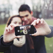 Cute young couple taking a self portrait — Stock Photo #41019717