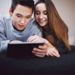 Relaxed teenage couple using digital tablet — Foto de Stock