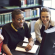 Young people enjoying studying in library — Stock Photo #43180045