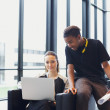 Two young students using laptop in campus — Stock Photo