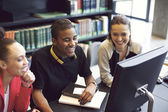 Young people enjoying studying in library — Stock Photo