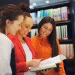 Three young university students studying together — Stockfoto