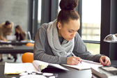 Young african american woman taking notes for her study — Foto Stock