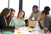 Multiethnic group of young people studying together — Stock Photo