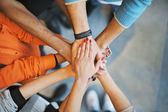 Stack of hands a symbol of teamwork — Stock Photo