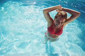 Woman making a splash in the pool — Stock Photo