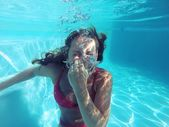 Young female holding her breath underwater — Stock Photo