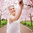 Beautiful woman enjoying spring day in park — Stock Photo #45588349