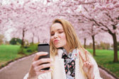 Attractive young woman posing for selfie — Stock Photo