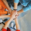 Group Of young people stacking their hands — Stock Photo #45815129