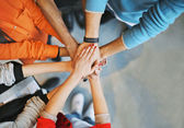 Group Of young people stacking their hands — Stock Photo