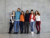 Multiethnic group of happy young university students on campus — Stock Photo