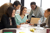 Multiracial young people enjoying group study — Stock Photo