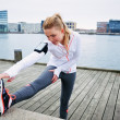 Female runner stretching before a run — Stock Photo #46585777