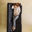 Young woman taking a nap on couch - Indoors — Stock Photo #47341575