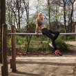 Постер, плакат: Fitness female taking rest after workout at park