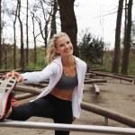 Beautiful young woman stretching before a run. — Stock Photo #47342163