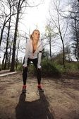 Young woman resting after jogging — Stock Photo