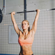 Fit young female athlete lifting heavy weights — Stock Photo #49225085