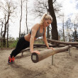 Fit young lady exercising in park — Stock Photo #50285733