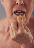 Taking a pill for good health — Stock Photo