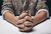 Praying hands of a senior woman — Stock Photo