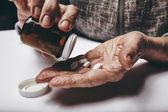 Senior woman taking medicine — Stock Photo