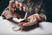 Elderly woman taking prescription medicine — Stock Photo