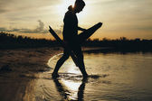 Young man going for spearfishing at evening — Stock Photo