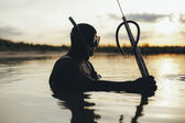 Underwater fisherman fishing with speargun — Stock Photo