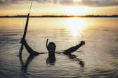 Enjoying spearfishing in evening — Stock Photo