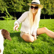 Laughing Woman Entices Dog — Stock Photo #7346076