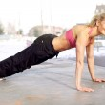 Beautiful happy fitness woman exercising — Stock Photo #9402487