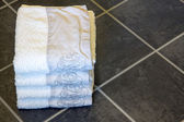 Towels in bathroom floor — Stock Photo