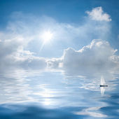 Clouds and sun reflection in water — Stock Photo