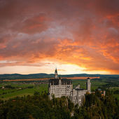 Neuschwanstein castle and majestic clouds — Stock Photo