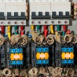Panel with circuit breakers and actuators — Stock Photo