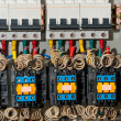 Stock Photo: Panel with circuit breakers and actuators