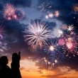 Happy family looks fireworks - Stock Photo