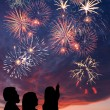 Happy family looks fireworks - Stockfoto