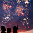 Happy family looks fireworks - Stok fotoğraf